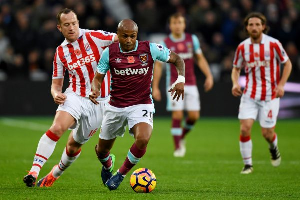 LONDON, ENGLAND - NOVEMBER 05:  Andre Ayew of West Ham United (R) is put under pressure from Glenn Whelan of Stoke City (L) during the Premier League match between West Ham United and Stoke City at Olympic Stadium on November 5, 2016 in London, England.  (Photo by Shaun Botterill/Getty Images)