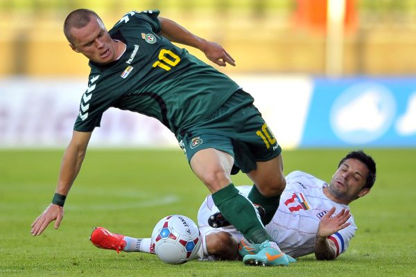 Darvydas Sernas (L) of Lithuania fights the ball with Mario Mutsch (R) of Luxembourg during their friendly game at Josy Barthel Stadium, Luxembourg, 14 August 2013.